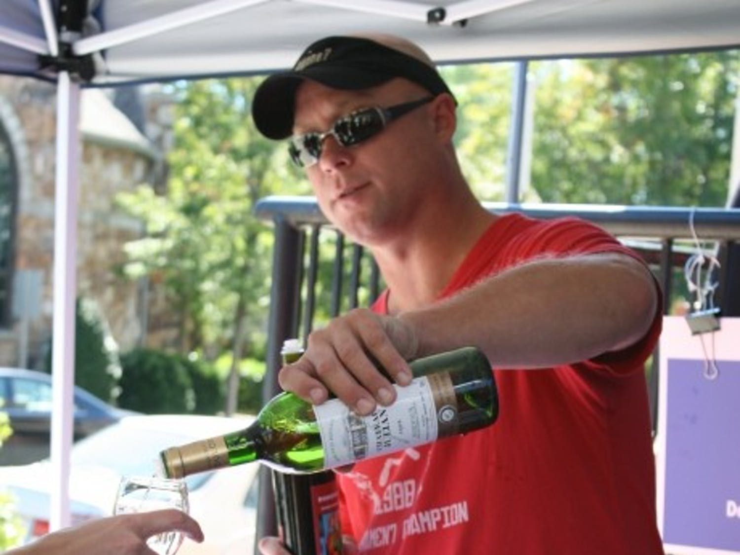 Dan Benthall pours a glass of wine at the Weaver Street Market 7th Annual Fall Wine Sale and Show at Southern Village on Saturday, Oct. 9, 2010.