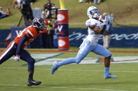 First-year wide receiver Dazz Newsome (19) catches UNC's first touchdown against UVA on Saturday at Scott Stadium. UNC lost to Virginia 21-31.