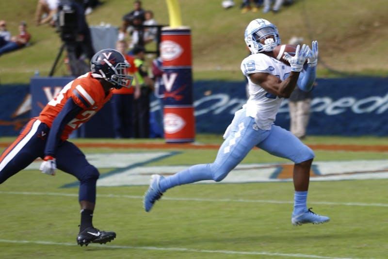 First-year wide receiver Dazz Newsome (19) catches UNC's first touchdown against UVA in 2018 at Scott Stadium. UNC lost to Virginia 21-31.