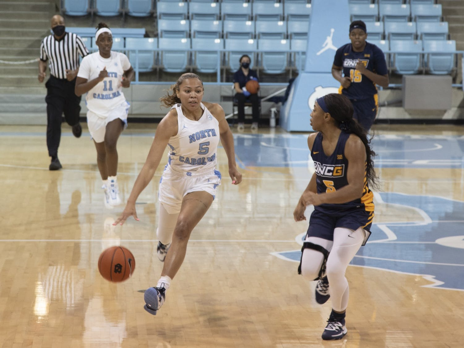 Graduate guard Stephanie Watts (5) drives the ball during the game against UNC-Greensboro in Carmichael Arena on Saturday, Nov. 28, 2020. The Tar Heels defeated the Spartans 96-35.