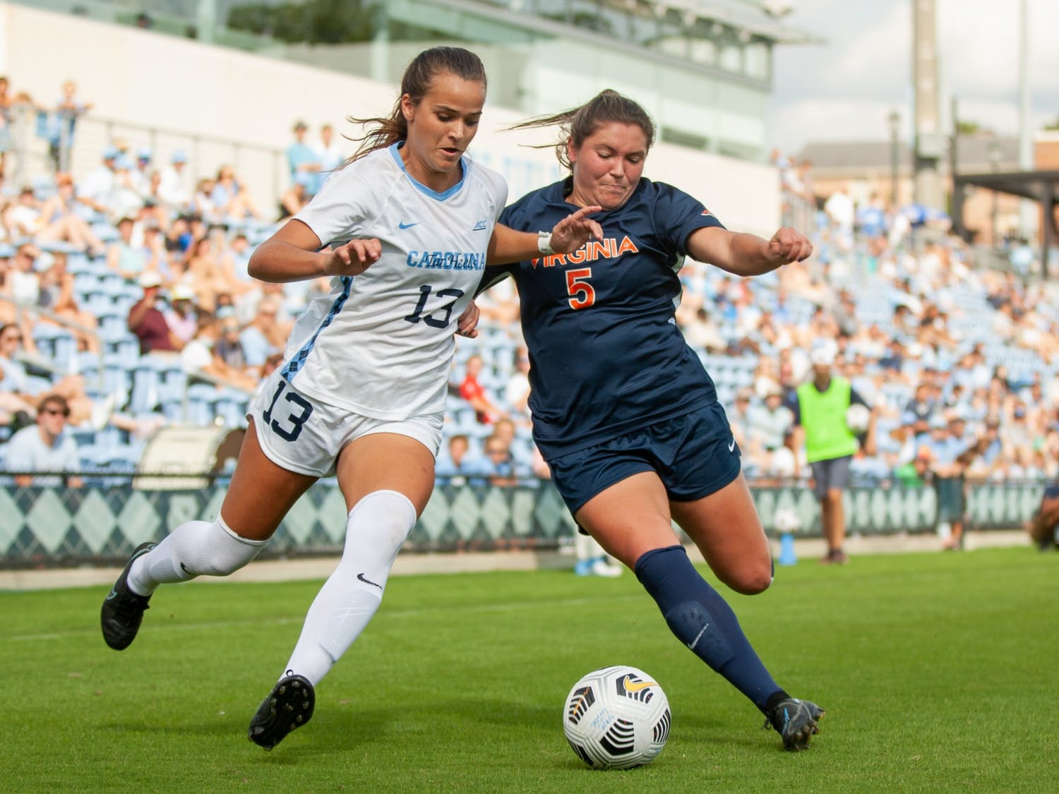 Junior forward Isabel Cox (13) runs with the ball at the game against Virginia on Oct. 3 at Dorrance Field. UNC tied 0-0.