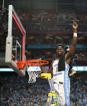 North Carolina wing Theo Pinson (1) holds up his part of the cut down net after defeating Gonzaga 71-65 in the NCAA men's basketball Championship Monday night in Phoenix.