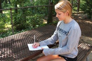 Katie Ford is one the women's swimming and diving team and also has a passion for drawing.