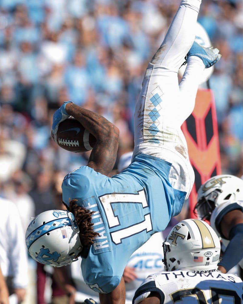 Wide receiver Anthony Ratliff-Williams (17) attempts to flip into the end zone against Georgia Tech Saturday, Nov. 3, 2018 at Kenan Memorial Stadium. UNC lost to Georgia Tech 38-28.