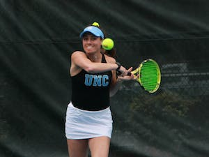 UNC senior Alexa Graham returns a volley during a doubles' match on March 28, 2021 at Cone-Kenfield Tennis Center. The Tar Heels defeated the Fighting Irish 7-0.