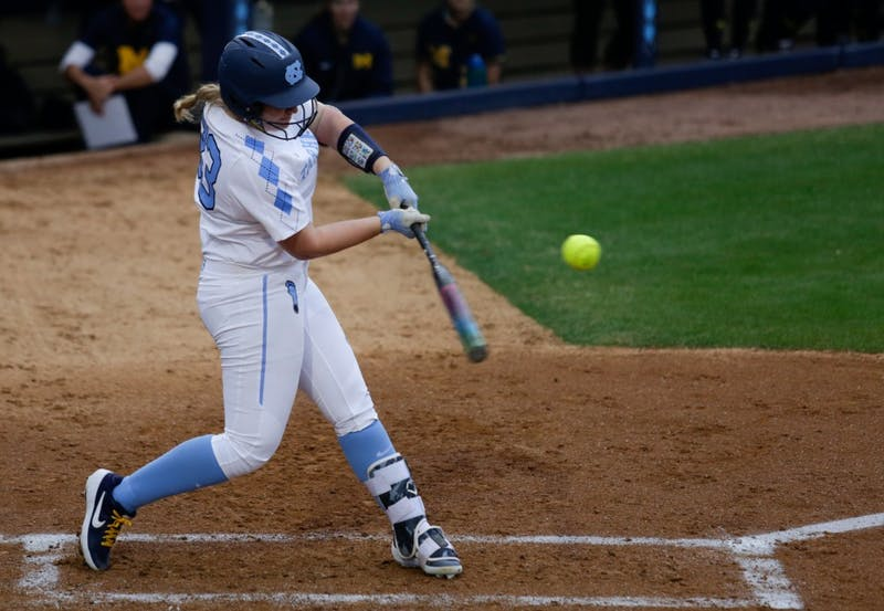 Zoe Goodman (33) swings against Michigan on Friday, Feb. 15, 2019 in Anderson Stadium.