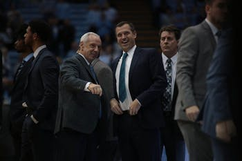 UNC Head Coach Roy Williams and UNCW Head Coach C. B. McGrath speak before tipoff in the Smith Center on Wednesday, Dec. 5, 2018.