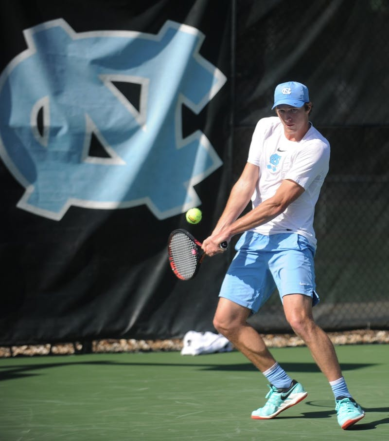 UNC men's tennis freshman Brian Cernoch prepares to return the ball in a singles match against the University of Oklahoma at Cone-Kenfield Tennis Center on Friday, Mar. 22, 2019. The No. 11 UNC men's tennis team beat No. 20 Oklahoma 4-1.