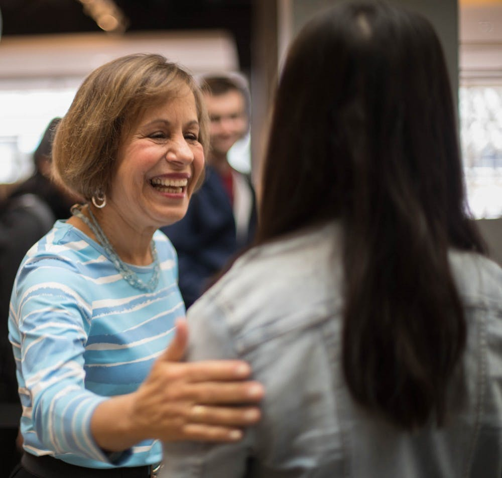 "Chancellor Carol Folt hosts ""Thank You, Carolina,"" an opportunity for students to take a selfie with her and get a slice of pizza in the Union on Tuesday, Jan. 29, 2019."