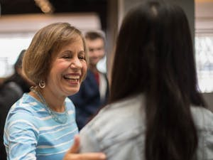 """Chancellor Carol Folt hosts """"Thank You, Carolina,"""" an opportunity for students to take a selfie with her and get a slice of pizza in the Union on Tuesday, Jan. 29, 2019."""
