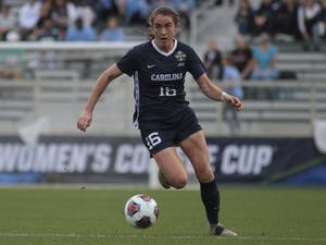 Senior defender Julia Ashley (16) dribbles down the field during the NCAA Championship against Florida State on Sunday, Dec. 2, 2018 at WakeMed Soccer Park. UNC lost 1-0.