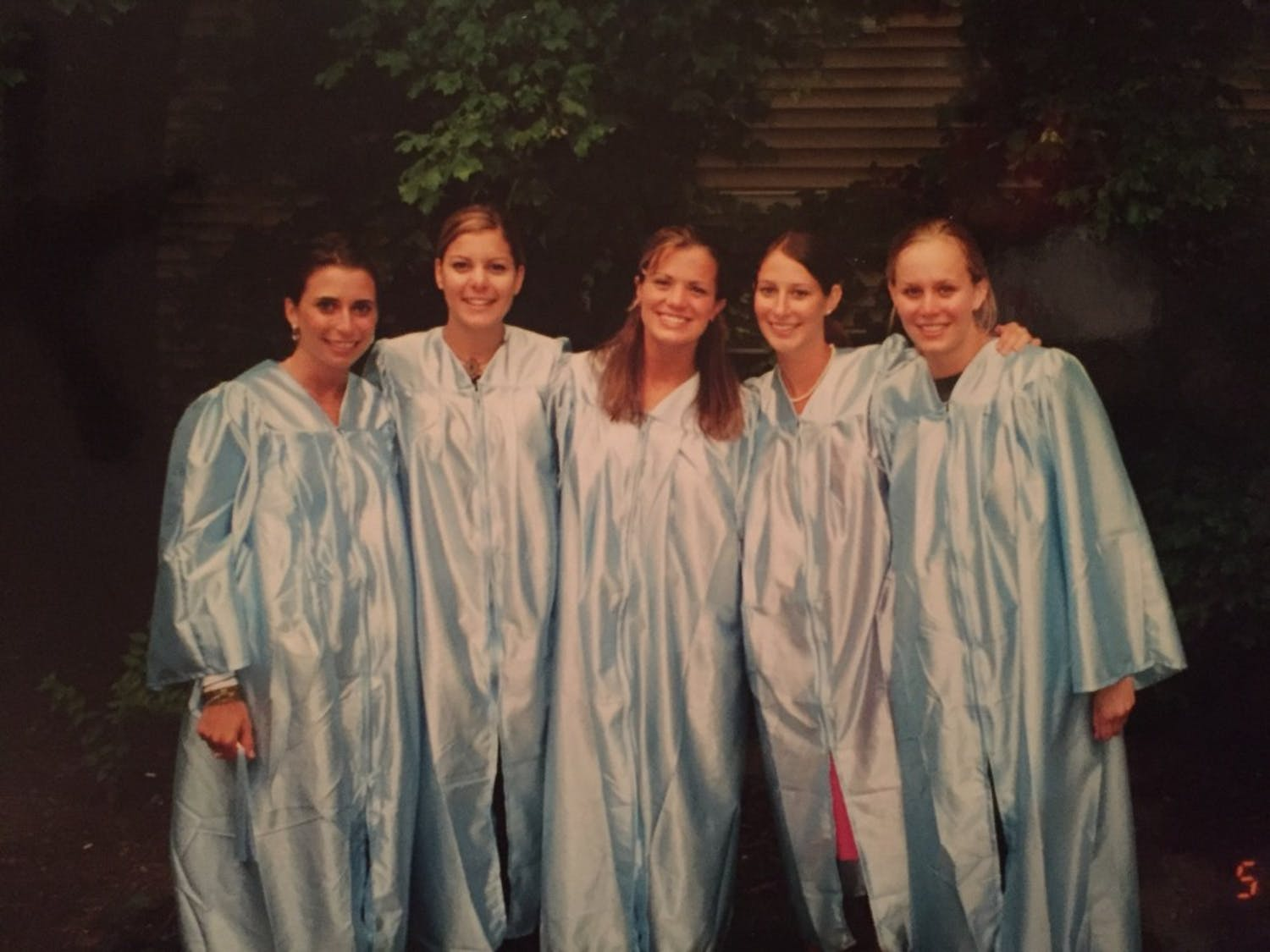 Melissa Egan (middle) graduated from UNC as a Dramatic Art major in 2003. Photo courtesy of Melissa Egan.
