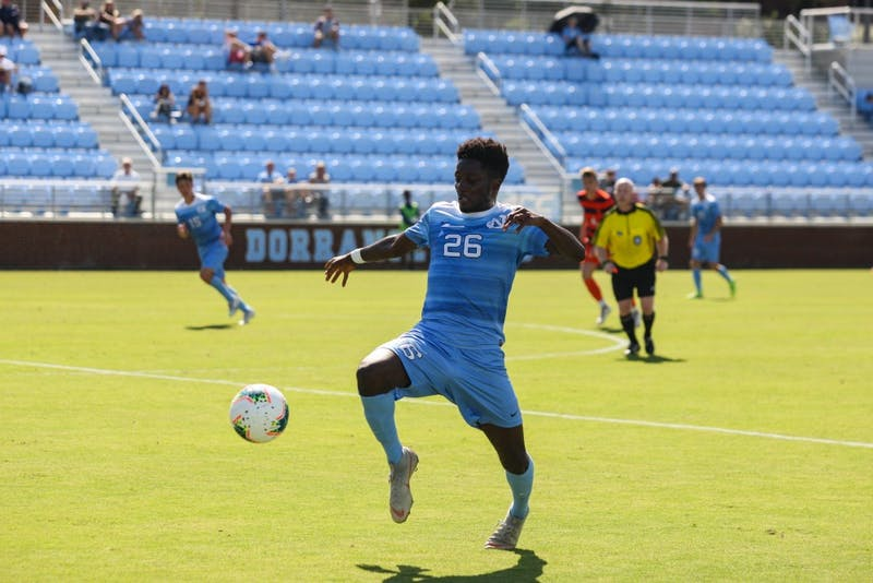 Senior forward Jelani Pieters (26) prepares to kick the ball during a game against Syracuse at Dorrance Field on Saturday, Oct. 12, 2019. The Tarheels lost 3-4.
