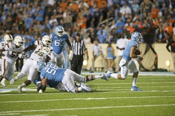 True first-year quarterback Sam Howell (7) scrambles against Miami on Saturday, September 7, 2019 at Kenan Stadium. The Tar Heels beat the Hurricanes, 28-25, in their home opener.