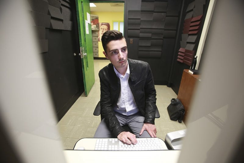 Aaron Lovett, a senior documentary producer, sits in the Swain Hall Media Lab. Lovett won the Pitchfest award at the RiverRun Film Festival in Winston Salem.