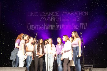 "UNC Cadence A Cappella performs at the UNC Dance Marathon. Carolina For The Kids Foundation hosted the marathon, a no-sitting, no-sleeping event comprised of over 2,000 students who remain standing for 24 hours at Fetzer Gym, on March 22 and March 23, 2019.  The event is a culmination of year-long fundraising efforts which raised $440,955.07. The money raised goes toward providing families with financial and emotional assistance at UNC Children's Hospital. Students who attended the marathon watched the basketball game between UNC and Iona, danced, watched musical performances and more. Students participated in the marathon for a various personal reasons, including having their own family members in the hospital or,  ""seeing how much of an impact we can have on a family,"" said Jessica Martinson, a junior and biology major."