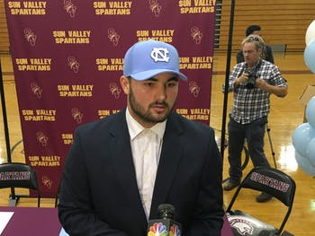 Sun Valley quarterback Sam Howell addresses the media after committing to UNC. Howell is North Carolina's all-time leader in total offense, with over 17,000 yard passing and rushing.