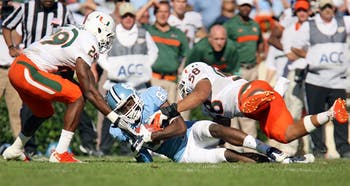 UNC wide receiver Dwight Jones is brought down by Miami's defense in the game on Saturday. UNC lost to Miami 30-24.