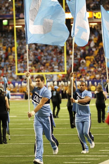 The UNC cheerleaders and Marching Tar Heels get the crowd of 68,919 revved up before kickoff.