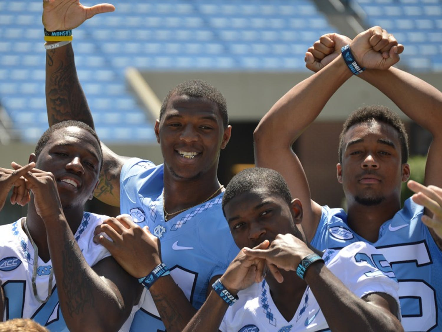 Quinshad Davis, Bug Howard, Damien Washington and Devin Perry posing for the camera.