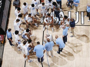 UNC men's basketball team talks during a time-out of the championship game of the Maui Invitational Tournament in Asheville, N.C. on Wednesday, Dec. 2, 2020. UNC lost the championship to Texas 69-67. Photo courtesy of Brian Spurlock/Camping World Maui Invitational.