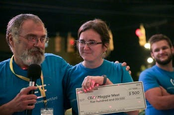 Steven Howser presents his donation to Maggie West at a CEF Fall Fundraiser. Photo courtesy of Steven Howser.