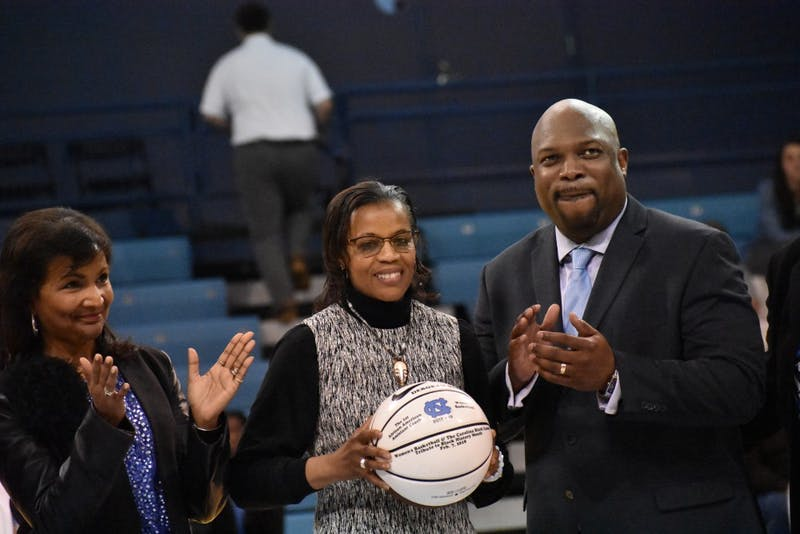 Deborah Stroman (middle) is honored during a Black History month ceremony on Feb. 7 in Carmichael Arena.
