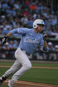 Sophomore Kyle Datres (3) runs between bases during the game against South Carolina on Tuesday.
