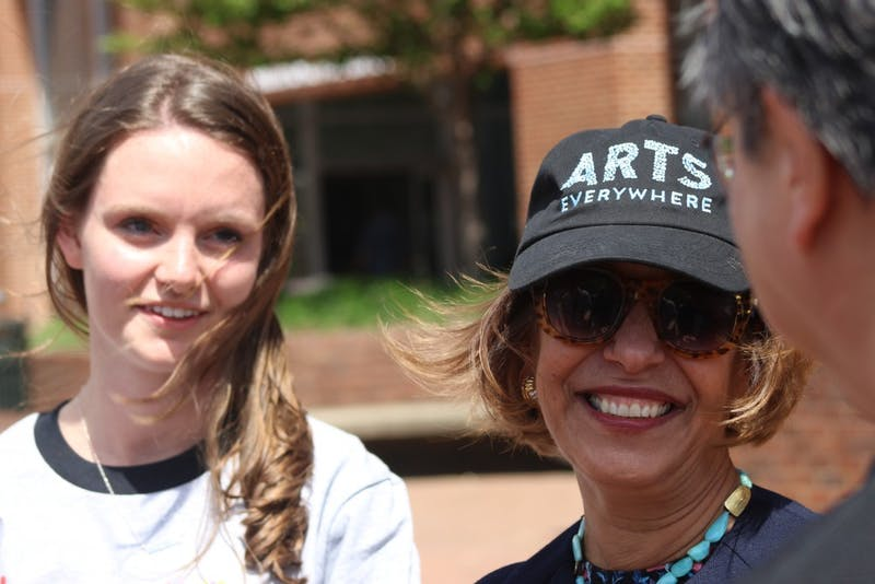 """Senior Biology major Rachael Purvis and Chancellor Carol Folt were interviewed Friday afternoon regarding the """"Before I Die..."""" art installment located near the Pit."""