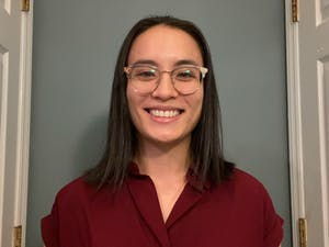 """UNC fourth-year dual degree medical and public health student Bao-Tran """"BT"""" Parker poses for a FaceTime portrait from her home in Durham on March 30, 2021. Parker was one of the six students to start the petition for an increase in AAPI representation within UNC CAPS."""