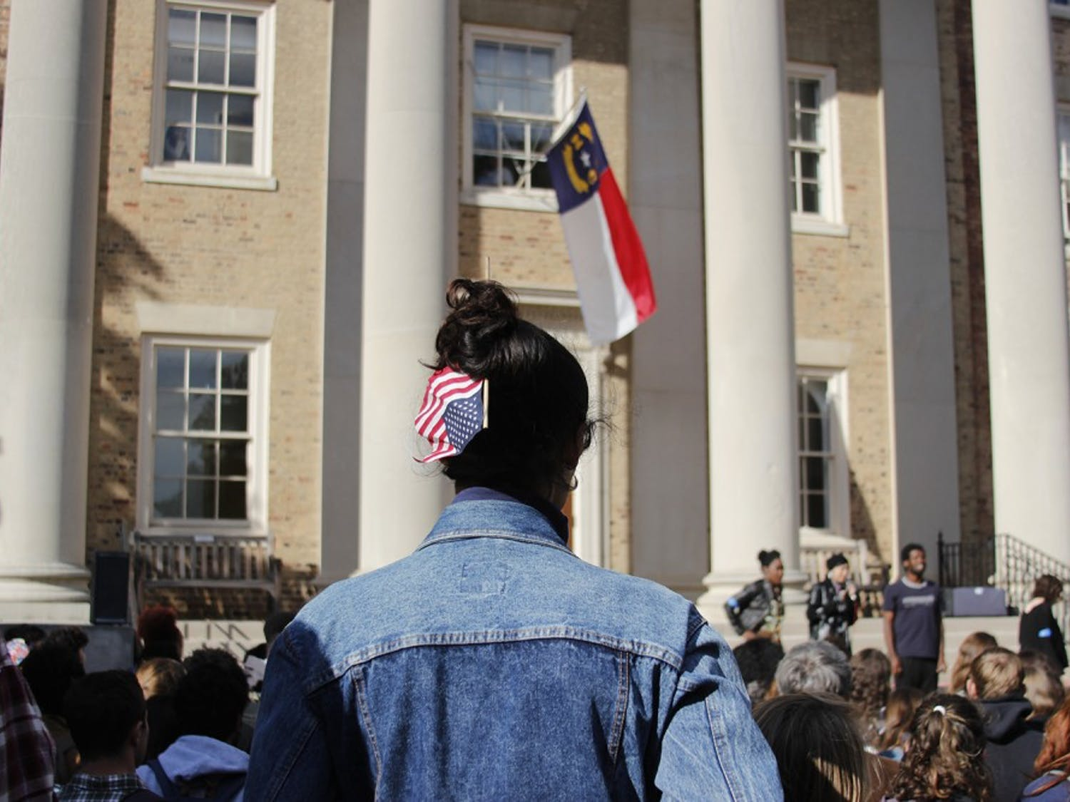 Students gathered on the steps of South Building to create a safe space to talk about the results of the presidential election and the effects of it on minority students. The event began with ground rules and was centered around an open mic. Various students walked around the space with blue armbands to act as marshals for safety. A safe space was offered in the Campus Y for those who felt unsafe.