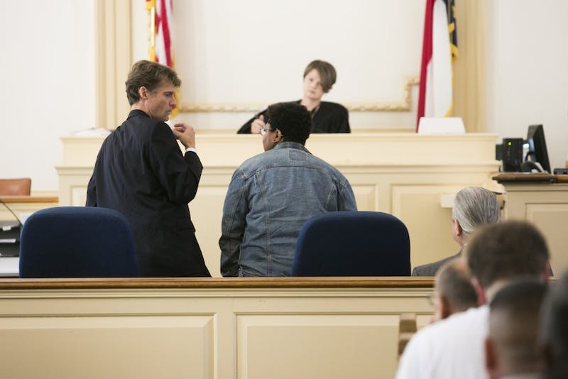 Maya Little and her lawyer converse at the start of her hearing on Monday, Oct. 15, 2018, in Hillsboro N.C.