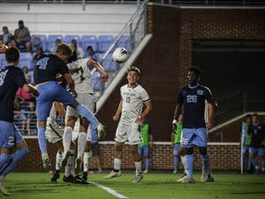 Freshman defender Blake Malone (4) heads the ball to score a goal during their game against Notre Dame on Friday, Sep. 20, 2019. UNC beat Notre Dame 2-0.