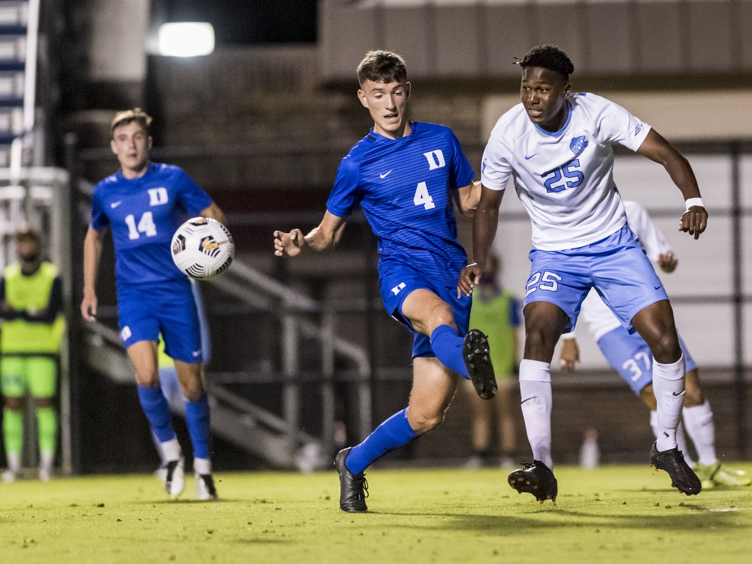 UNC freshman forward Akeim Clark (25) races Duke players for the ball at the game on Friday, October 2, 2020 in Koskinen Stadium. UNC won 2-0.