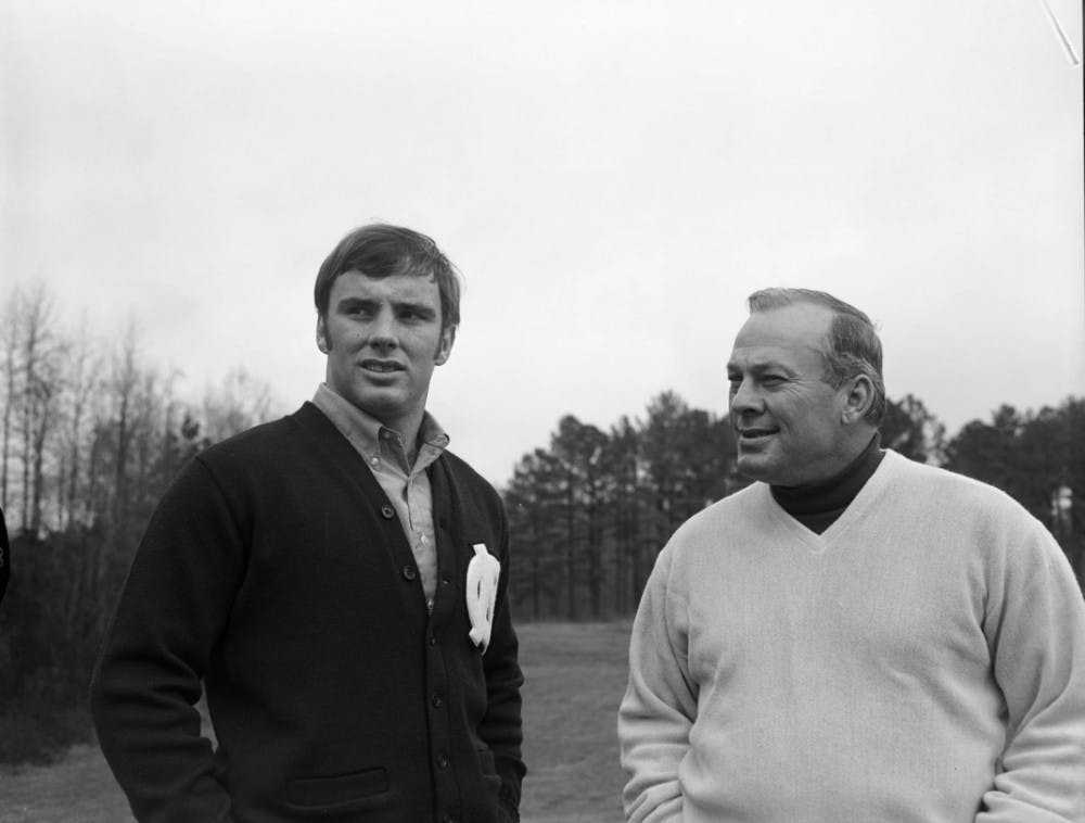 """<p>Former <span class=""""caps"""">UNC</span> football player Don McCauley (left) stands with Charlie """"Choo Choo"""" Justice in the early 1970s.  Photo courtesy of Wilson Library.</p>"""