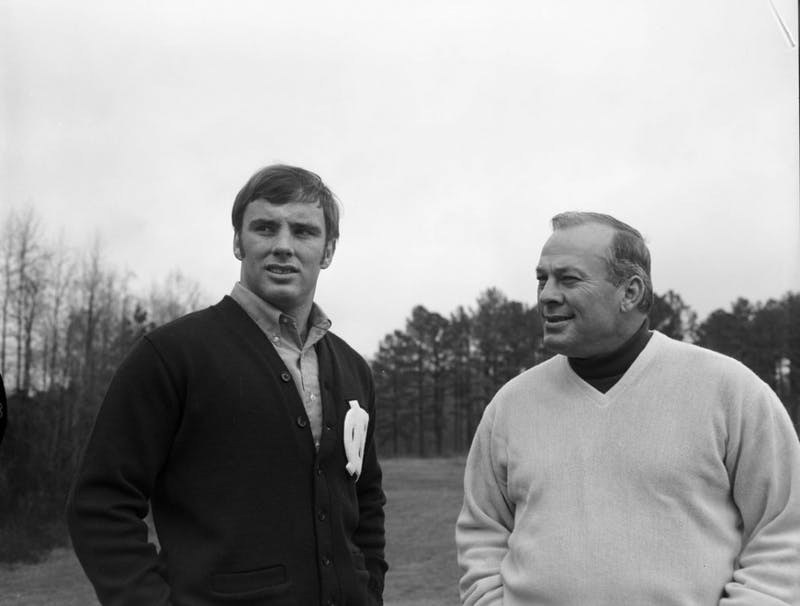 """Former UNC football player Don McCauley (left) stands with Charlie """"Choo Choo"""" Justice in the early 1970s.  Photo courtesy of Wilson Library."""
