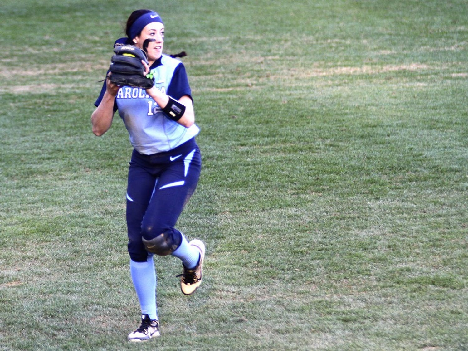 Kristen Brown (12) tosses off the ball during the softball game against Georgetown University on February, 28.