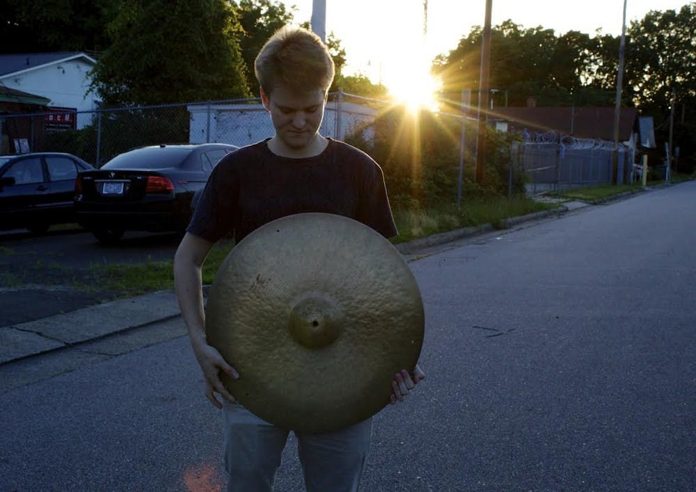 <p>Atticus Reynolds is a UNC senior who composes the music and plays the drums on the EMIT EP. Photo Courtesy of Atticus Reynolds.</p>
