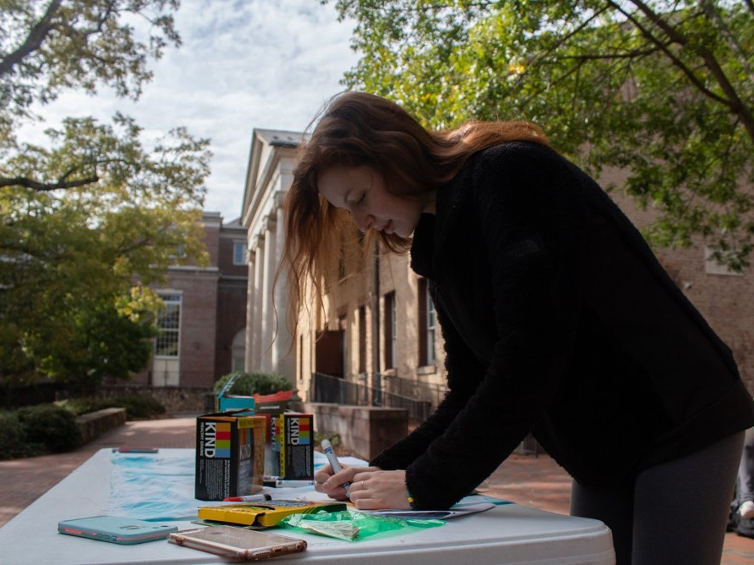 Cassie Teixeira, a first-year exercise and sport science major, writes about physical activities she is grateful for in front of the Campus Y on Monday, Nov. 4, 2019.
