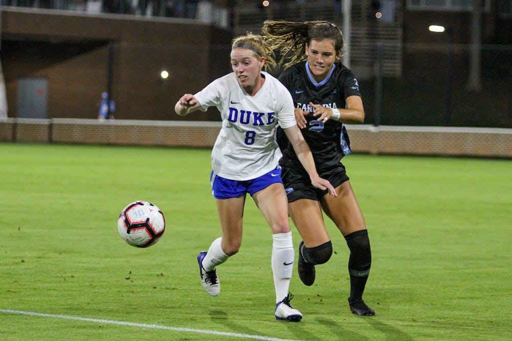 UNC freshman defender Abby Allen (2) defends against Duke senior forward Tess Boade (8) on Dorrance Field Oct. 23, 2020. The Tar Heels beat the Blue Devils 1-0.
