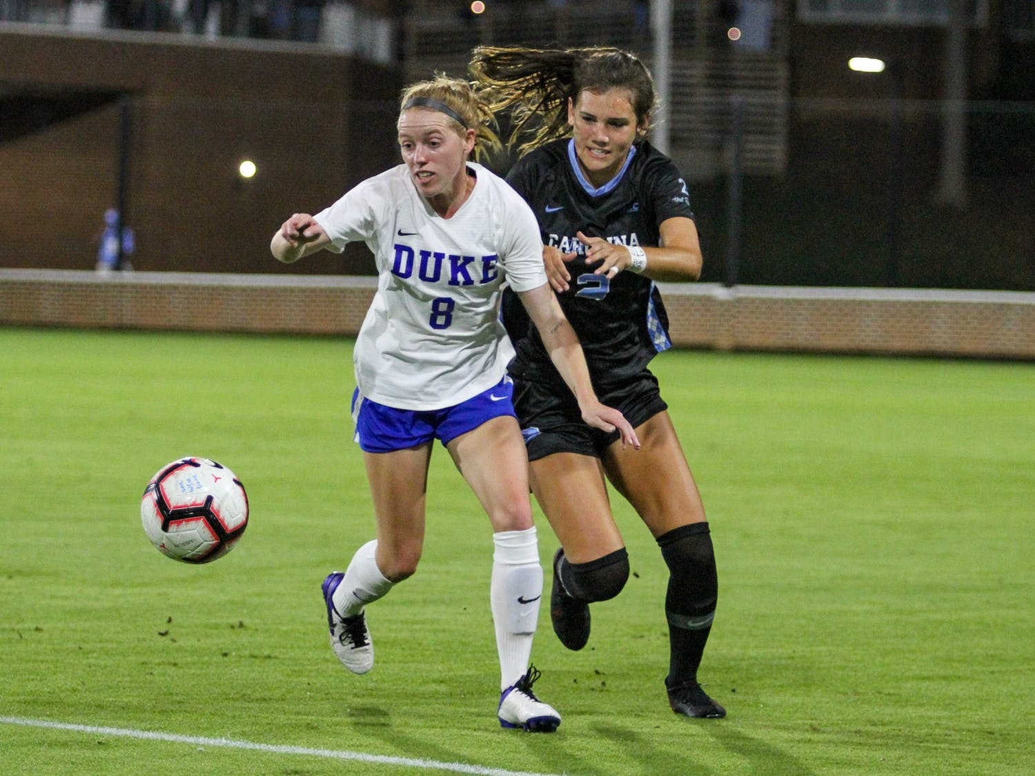 UNC freshman defender Abby Allen (2) defends against Duke senior forward Tess Boade (8) on Dorrance Field Oct. 23, 2020. The Tar Heels beat the Blue Devils 1-0.