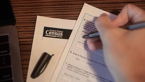 DTH Photo Illustration. A student fills out the United States Census. The 2020 Census is a critical way for students to stay civically engaged and for their voices to be counted for.