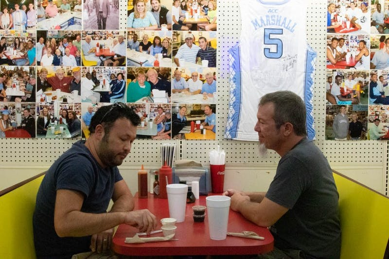 Scott Zentz of Durham and David Hill of Graham, both systems specialists in UNC's biostatistics department, enjoy lunch at Sutton's Drug Store on Franklin Street.