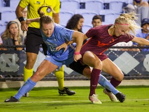 UNC sophomore forward Avery Patterson (15) attempts to retrieve the ball back from her opponent during a women's soccer game against Virginia Tech on Sept. 23, 2021, at Dorrance Field. UNC tied 2-2.