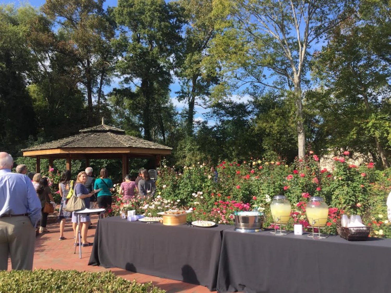 Strowd Roses Inc. board members, grant recipients and members of charitable organizations gather at the Gene Strowd Community Rose Garden in Chapel Hill.