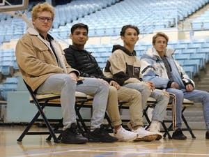 (From left) UNC wrestlers Clay Lautt, Jaime Hernandez, Joey Melendez and Zach Sherman have built bonds experiencing the season as teammates and as roommates. Photo courtesy of UNC Athletics.