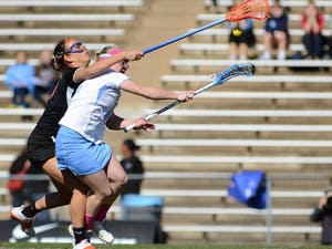 UNC Junior Attacker Abbey Friend (18) scores a goal in the first half. Abbey had 2 goals in the game.