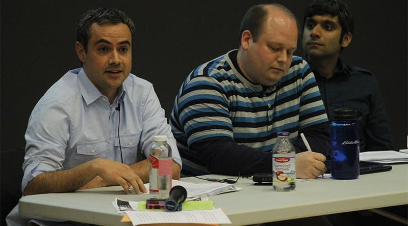 Yousuf Al-Bulushi, left, Nathan Swanson, middle, and Neel Ahuja participate in a forum.