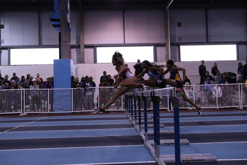 Runners compete in the women's hurdles event during the Dick Taylor Carolina Cup on Jan. 13 in Eddie Smith Field House.