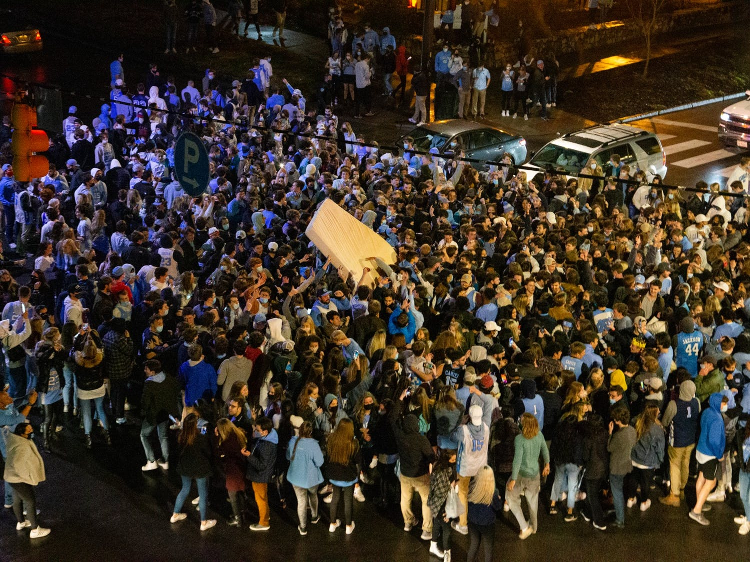 UNC fans rush Franklin Street after UNC's basketball team triumphs over Duke despite COVID-19 restrictions on Saturday, Feb. 6, 2021.